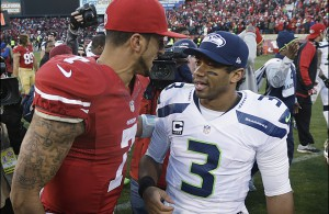 FILE - In this Dec. 8, 2013, file photo, San Francisco 49ers quarterback Colin Kaepernick, left, talks with Seattle Seahawks quarterback Russell Wilson (3) after an NFL football game in San Francisco. The 49ers beat the Seahawks 19-17. The Seahawks host the 49ers in the NFC championship on Sunday.  (AP Photo/Marcio Jose Sanchez)