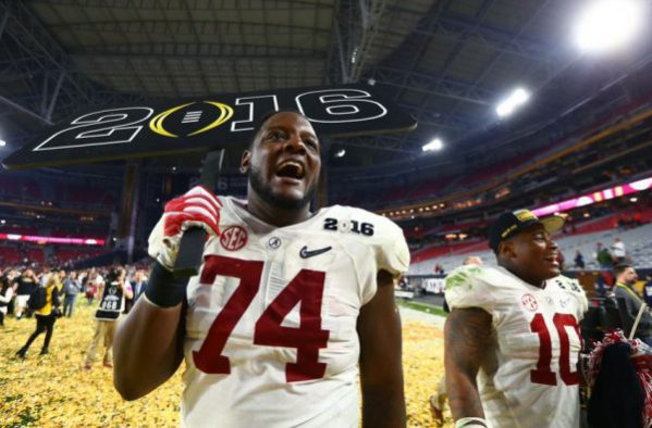 Jan 11, 2016; Glendale, AZ, USA; Alabama Crimson Tide offensive lineman Cam Robinson (74) and linebacker Reuben Foster (10) celebrate after defeating the Clemson Tigers in the 2016 CFP National Championship at University of Phoenix Stadium. Mandatory Credit: Mark J. Rebilas-USA TODAY Sports