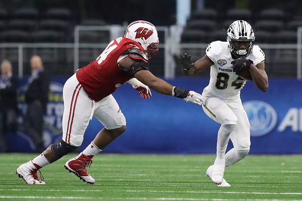 ARLINGTON, TX - JANUARY 02: A.J. Taylor #84 of the Wisconsin Badgers runs in the fourth quarter during the 81st Goodyear Cotton Bowl Classic between Western Michigan and Wisconsin at AT&T Stadium on January 2, 2017 in Arlington, Texas.  (Photo by Ronald Martinez/Getty Images)